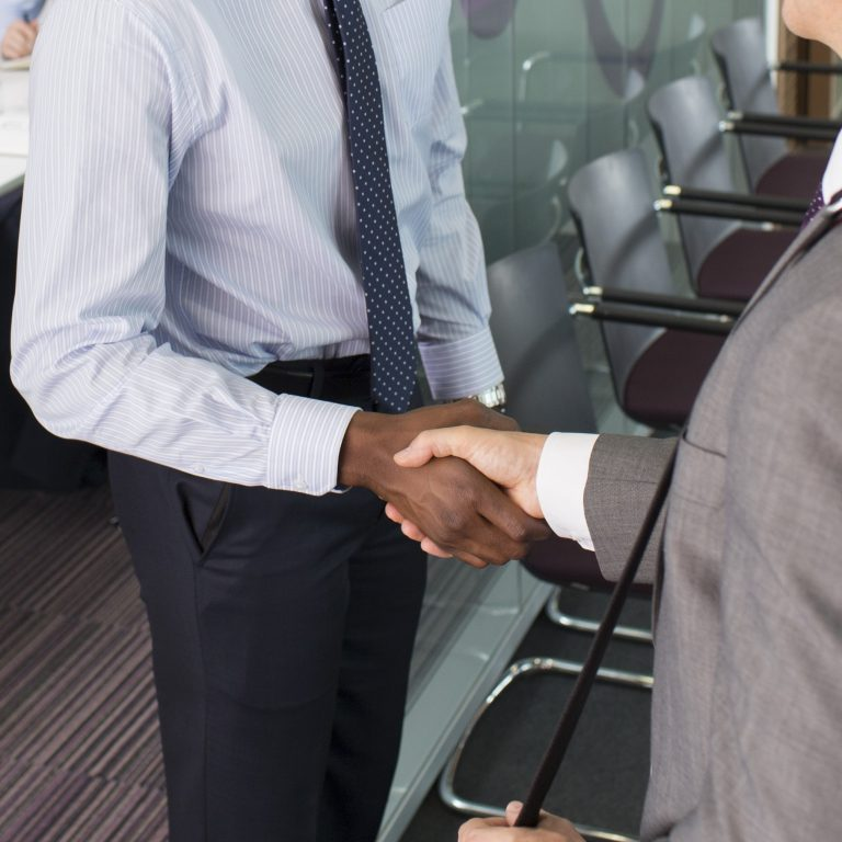 Two men shaking hands on the business deal.
